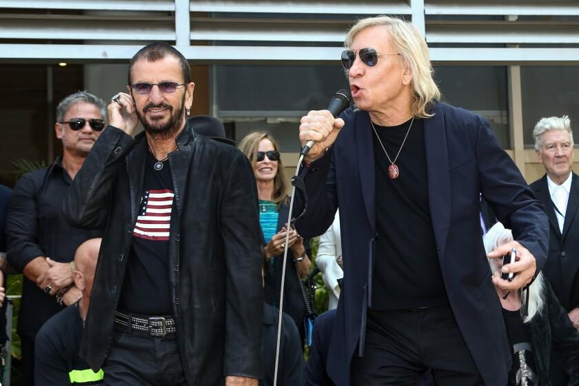Ringo Starr, left, and rocker Joe Walsh