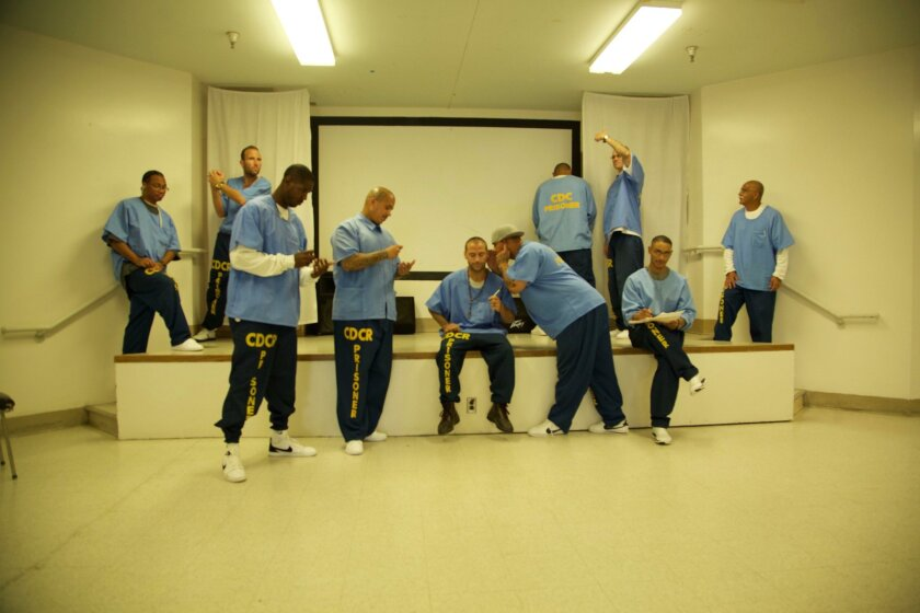 Inmates from the Richard J. Donovan Correctional Facility participate in a theater exercise as part of the Playwrights Project, which is presenting their original work at SDSU this month. In the back row are, left to right, Barney Mills, Robert Kennedy, Rudy Chavez, Corey Root and Ralph Niz. In the