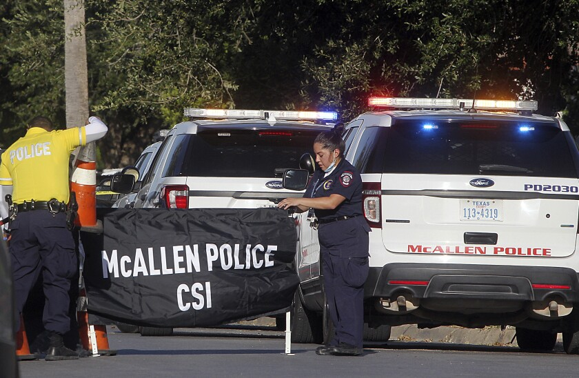 Investigators seal off the scene of a McAllen, Texas, shooting that killed two police officers.