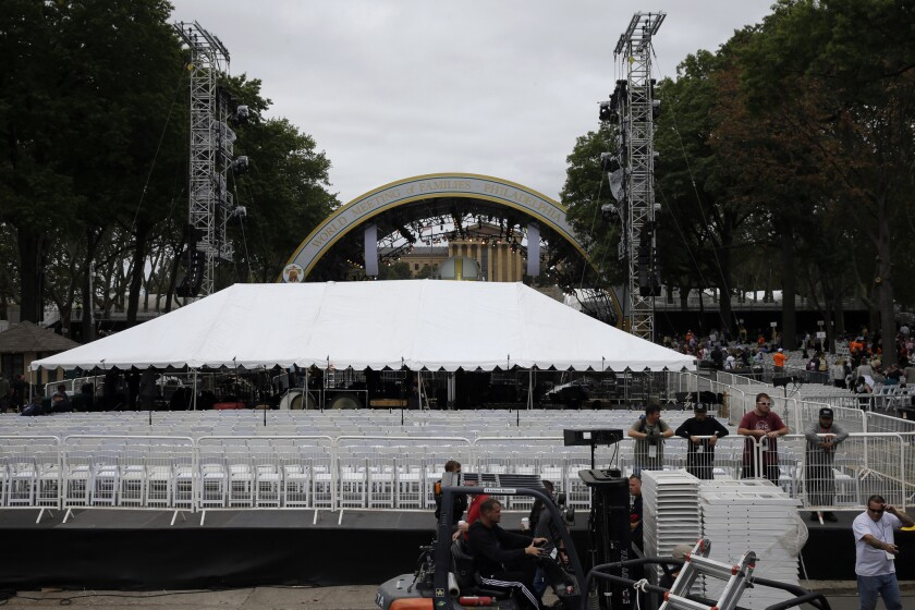 A tent blocks the view of the stage before a Mass by Pope Francis, causing the crowd gathered on the Benjamin Franklin Parkway to protest.
