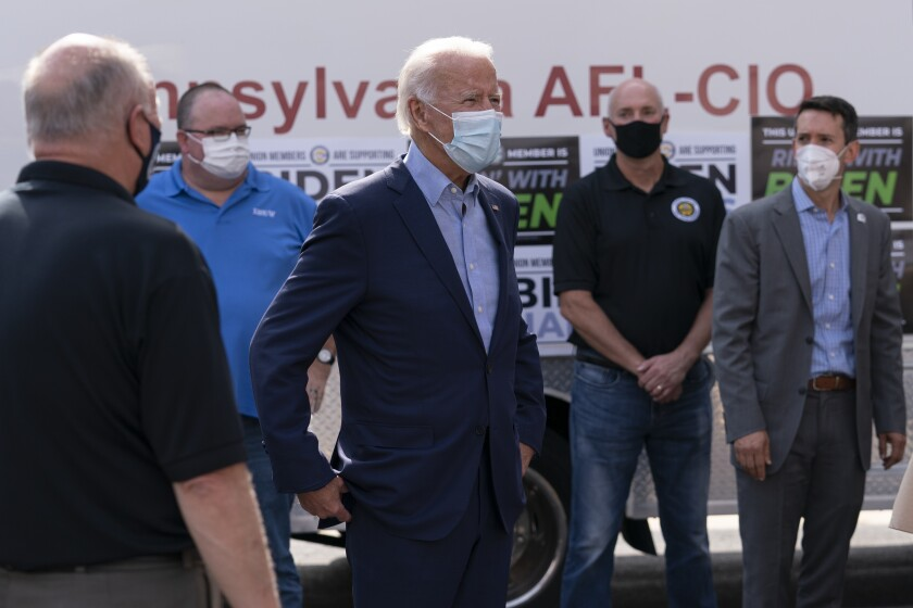 Democratic presidential candidate Joe Biden talks with union leaders in Harrisburg, Pa., Monday, Sept. 7, 2020.