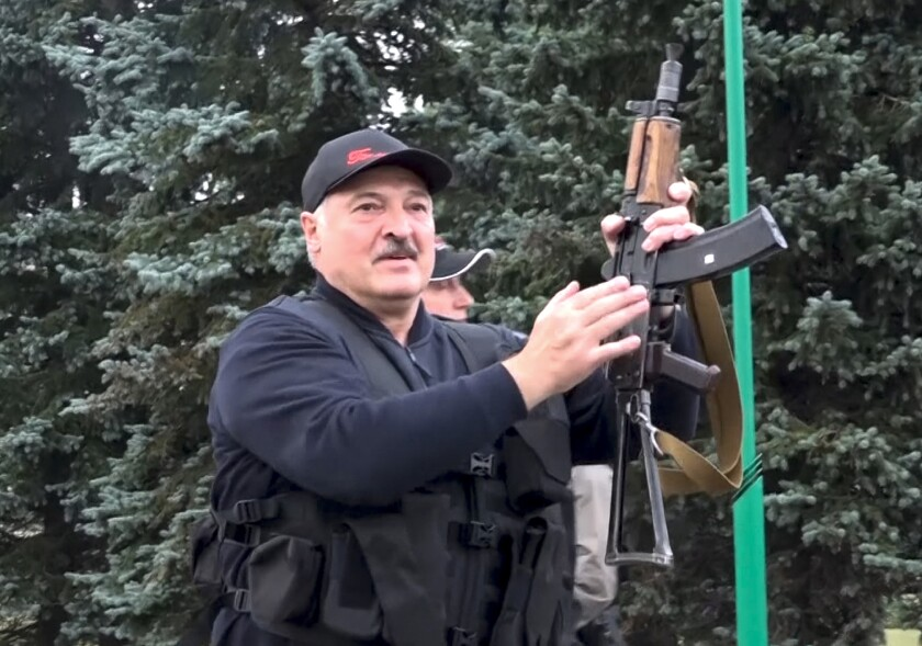 Belarus President Alexander Lukashenko armed with a Kalashnikov-type rifle