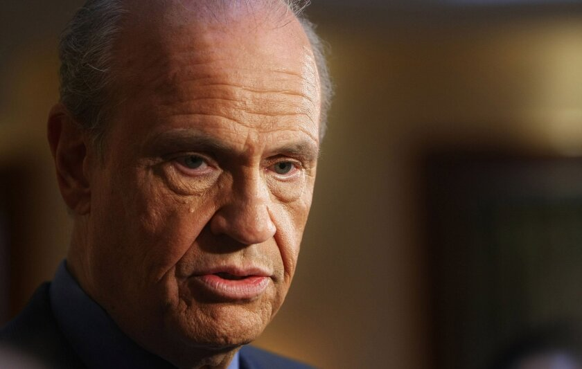 Fred Thompson speaks to the media during a campaign stop in New York City on Nov. 15, 2007.