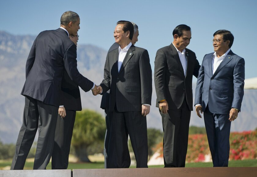 President Barack Obama shakes hands with Vietnam Prime Minister Nguyen Tan Dung, after posing for a group photo with other leaders of ASEAN, the 10-nation Association of Southeast Asian Nations, Tuesday, Feb. 16, 2016, at the Annenberg Retreat at Sunnylands in Rancho Mirage, Calif. Also on stage ar