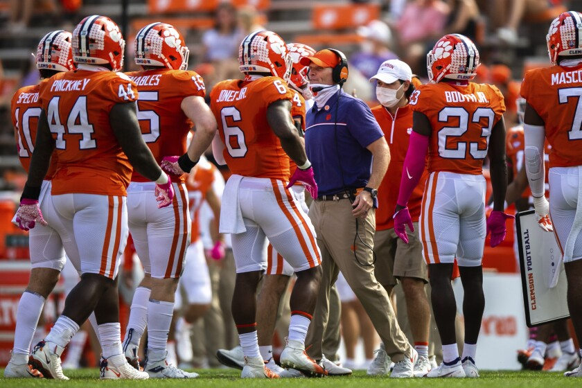 Clemson defensive coordinator Brent Venables, center right, talks to his players during an NCAA college football game against Syracuse in Clemson, S.C., Saturday, Oct. 24, 2020. (Ken Ruinard/Pool Photo via AP)