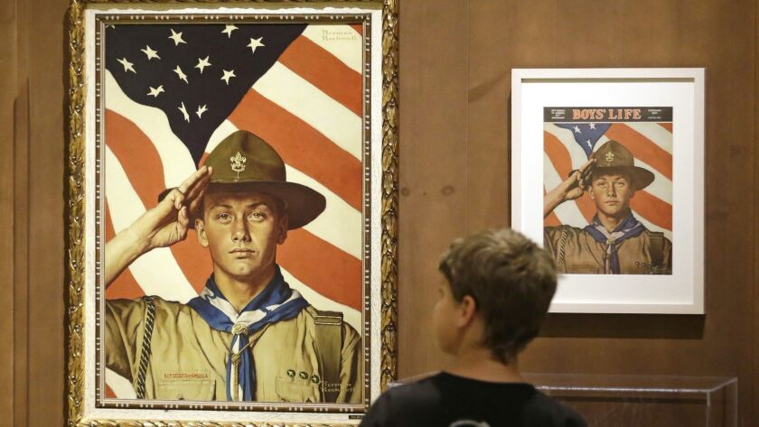 Boy Scout-themed Norman Rockwell paintings are on display at the Mormon Church History Museum in Salt Lake City in 2013. The church said Tuesday it will cut ties with the Boy Scouts of America.