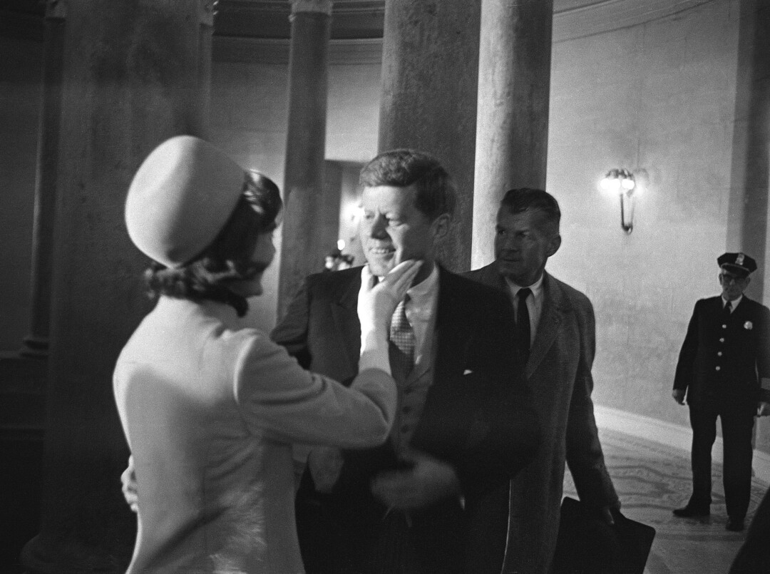 Black-and-white photo of Jacqueline Kennedy and President John F. Kennedy.