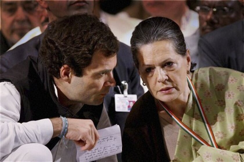 India's Congress party leader Rahul Gandhi, left, talks to his mother and party president Sonia Gandhi at a meeting of the party in Jaipur, India, Sunday, Jan. 20, 2013. Rahul Gandhi, the scion of India's Nehru-Gandhi political dynasty, was Saturday appointed the party vice president. The elevation