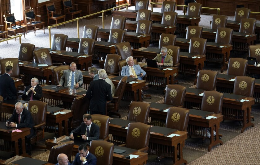 Empty seats are seen in the House Chamber at the Texas Capitol, Tuesday, July 13, 2021, in Austin, Texas. Texas Democrats left the state to block sweeping new election laws, while Republican Gov. Greg Abbott threatened them with arrest the moment they return. (AP Photo/Eric Gay)