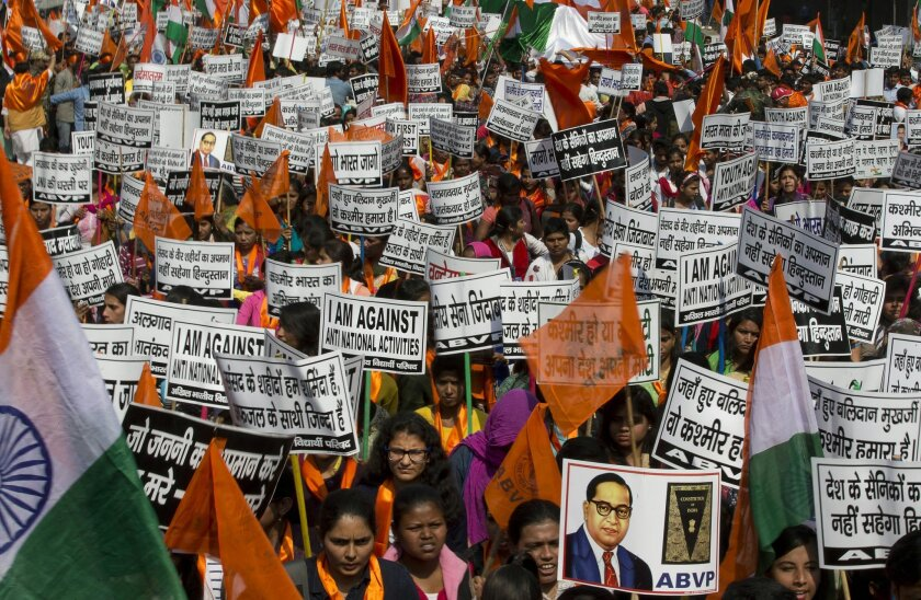 """Students of the Akhil Bharatiya Vidyarthi Parishad (ABVP) or All Indian Student Council, a student wing of the ruling Bharatiya Janata party, shout pro India slogans during a march in New Delhi, India, Wednesday, Feb. 24, 2016. The students demanded strict action against those indulging in anti-national activities, especially in the light of what happened in a New Delhi university where anti-India slogans calling for the destruction of India and independence for the Indian portion of Kashmir were allegedly shouted two weeks ago. Some banners in the local language read: """"India will not tolerate the insult of its soldiers, we are shameful that friends of Afzal Guru are still alive,"""" and """"Kashmir is part of India."""" (AP Photo/Manish Swarup)"""