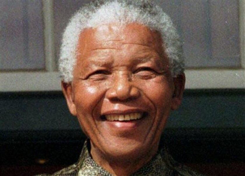 """FILE - In this May 11, 1999 file photo, South African President Nelson Mandela, is photographed in Cape Town, South Africa. Mandela, the former South African president and anti-apartheid leader, was admitted to a hospital on Saturday, March 9, 2013, for a scheduled medical check-up and doctors say there is no cause for """"alarm,"""" the president's office said. (AP Photo, File)"""