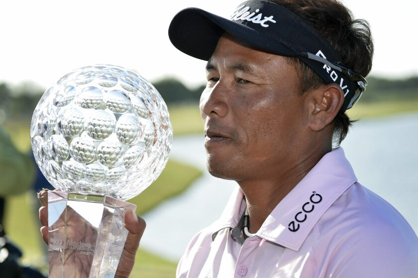Thongchai Jaidee of Thailand poses with his trophy after winning the Nordea Masters at PGA National, Malmo, Sweden, Sunday June 1, 2014. (AP Photo/Anders Wiklund, TT News Agency) SWEDEN OUT