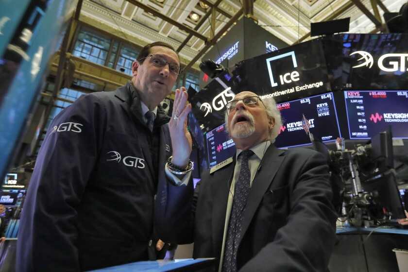 Traders work on the floor of the New York Stock Exchange earlier in the week. T