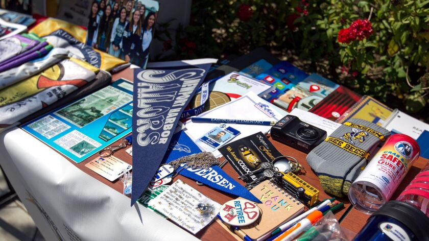 Items are displayed that will be placed in a time capsule during an event at the Newport-Mesa Unified School District offices on Friday.