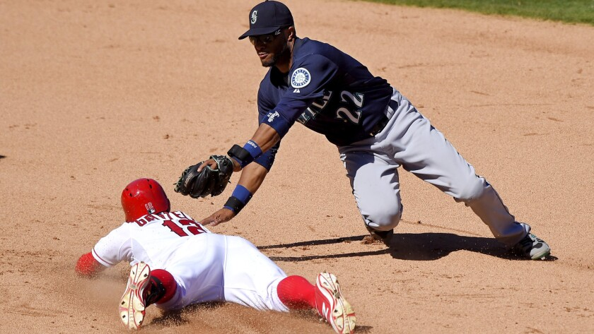 Angels second baseman Johnny Giavotella slides safely into second base with a double against Mariners second baseman Robinson Cano for a double in the eighth inning Saturday afternoon.