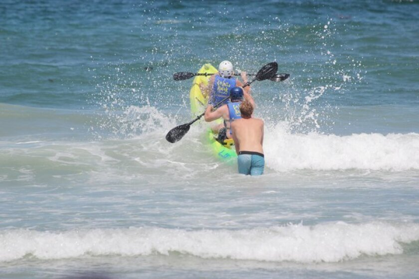 Kayakers head out over the surf. Photos by Phil Dailey