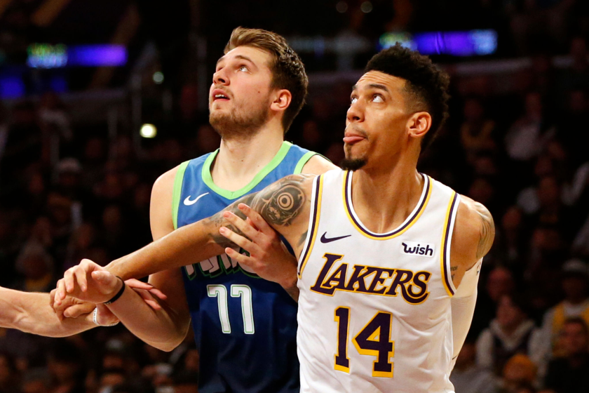 Dallas Mavericks guard Luka Doncic battles for position with Lakers guard Danny Green.