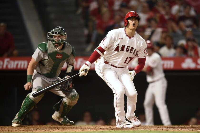 Angels designated hitter Shohei Ohtani reacts after a strike.