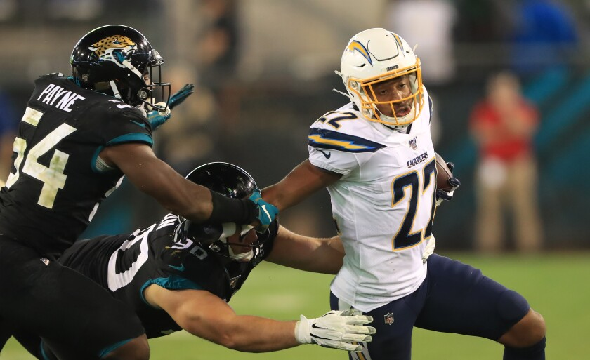 Chargers' Justin Jackson rushes for yardage during a game against the Jacksonville Jaguars on Dec. 08, 2019.
