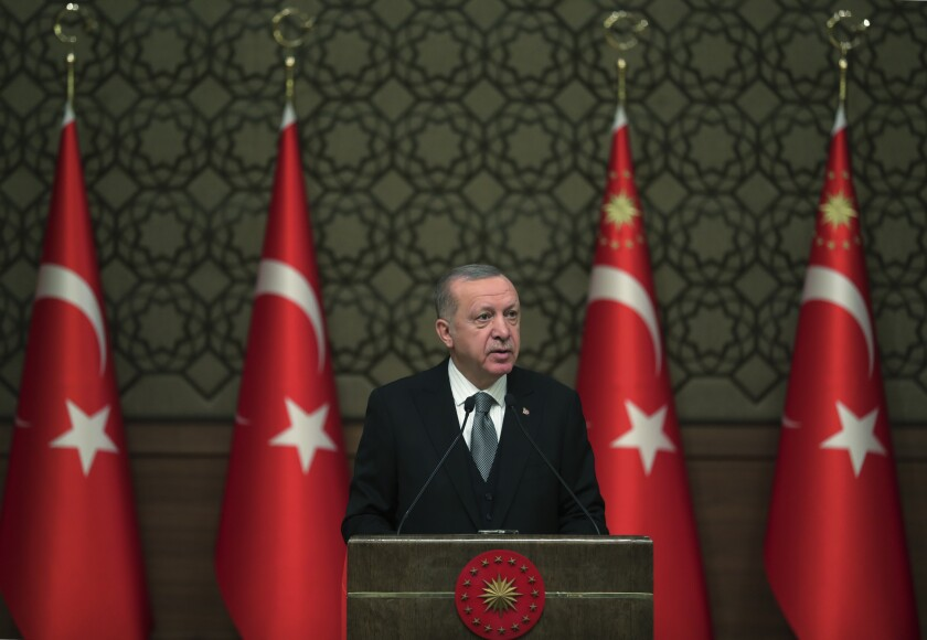 Turkish President Recep Tayyip Erdogan delivers a speech at an event in Ankara on Jan. 2, 2020, the day Turkey's parliament authorized the deployment of troops to Libya.