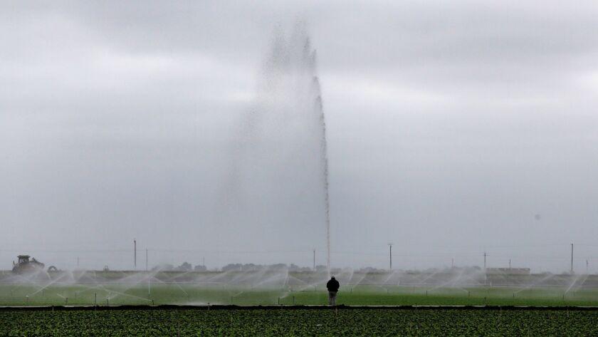 Watering crops outside Salinas