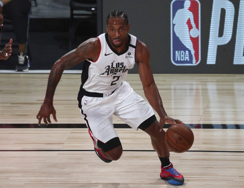 Los Angeles Clippers' forward Kawhi Leonard (2) controls the ball against the Denver Nuggets during the first half of an NBA basketball game Wednesday, Aug. 12, 2020, in Lake Buena Vista, Fla. (Kim Klement/Pool Photo via AP)
