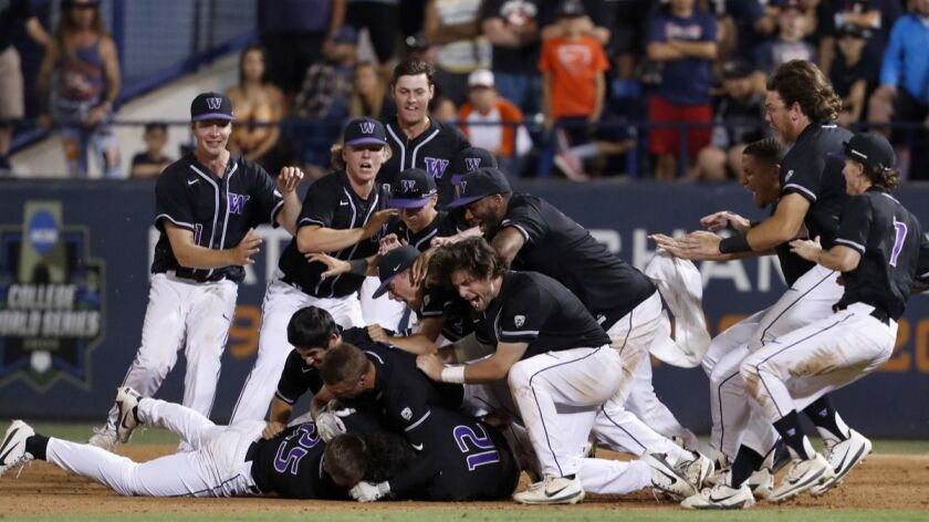 Washington players celebrate after beating the Cal State Fullerton in the 10th inning of an NCAA col
