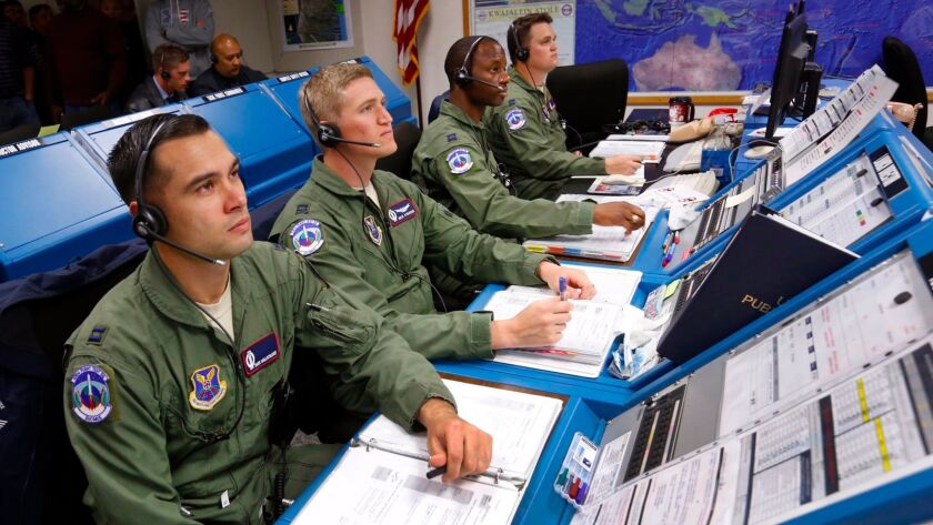 Members of the 576th Flight Test Squadron and Vandenberg Air Force Base monitor the launch of an una