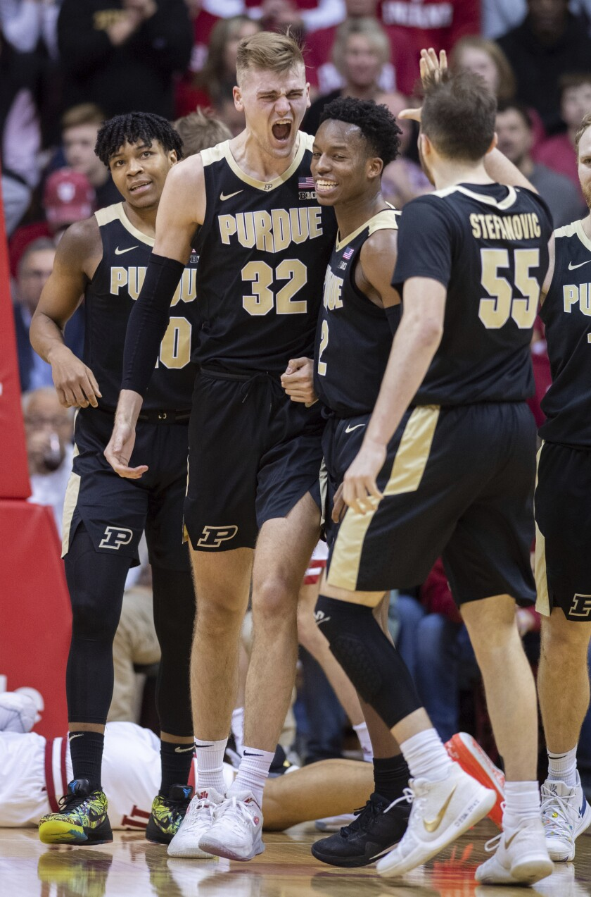 Purdue center Matt Haarms (32) reacts with his teammates after drawing a charging foul against Indiana during the second half of an NCAA college basketball game, Saturday, Feb. 8, 2020, in Bloomington, Ind. Purdue won 74-62. (AP Photo/Doug McSchooler)