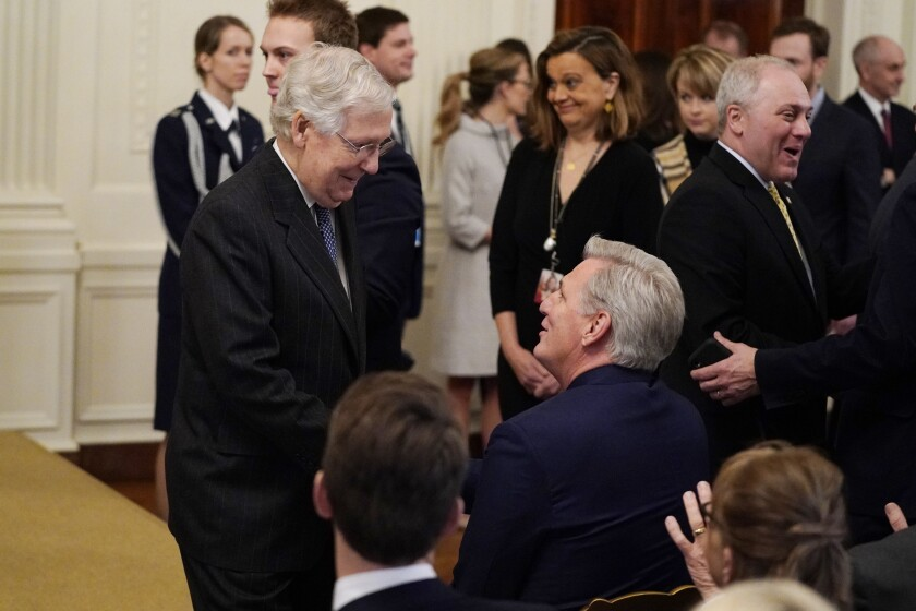 Senate Majority Leader Mitch McConnell, R-Ky., left, talks with House Minority Leader Kevin McCarthy of Calif., as they arrive to hear President Donald Trump speak in the East Room of the White House, Thursday, Feb. 6, 2020, in Washington. (AP Photo/ Evan Vucci)