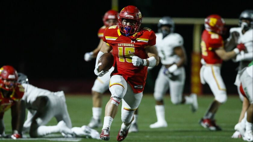 Cathedral Catholic running back Shawn Poma (15) rushes for a 33 yard touchdown in the first quarter against Narbonne.