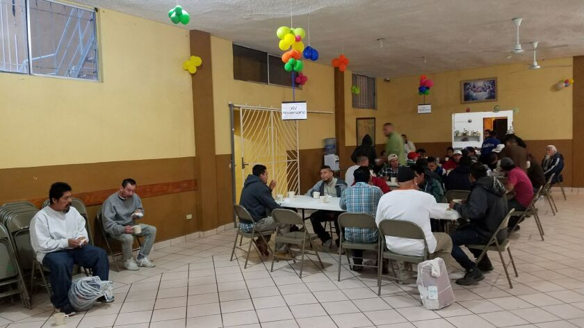 Migrants and deportees at Casa Migrante shelter run by Catholic priests in the border city of Nuevo