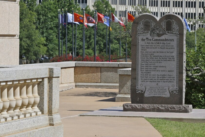 The Ten Commandments monument at the state Capitol in Oklahoma City. The state Supreme Court ruled that the monument violates the state constitution and therefore must be removed.