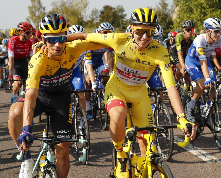 Primoz Roglic gets a hug during the 21st and last stage of the Tour de France.