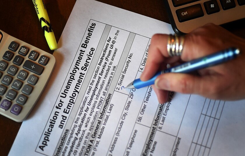 A person files an application for unemployment benefits on April 16 in Arlington, Va.