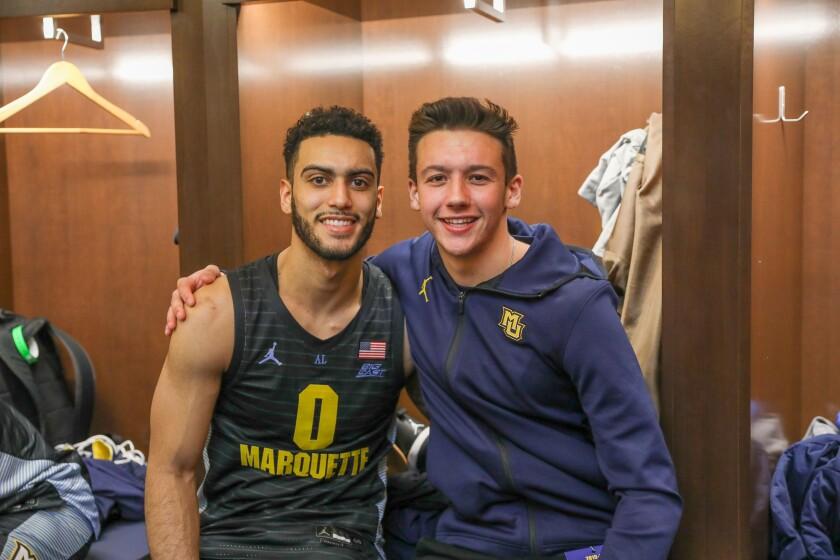 Torrey Pines basketball player Nick Herrmann (right) meets Marquette basketball player Markus Howard on Herrmann's Make-A-Wish trip.