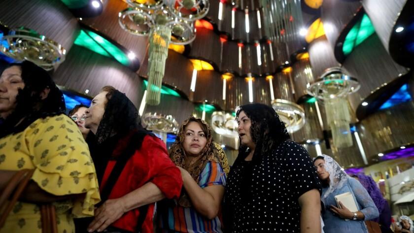 GUADALAJARA, JALISCO -- SUNDAY, JUNE 16, 2019: Women exit the temple at the conclusion of La Luz del
