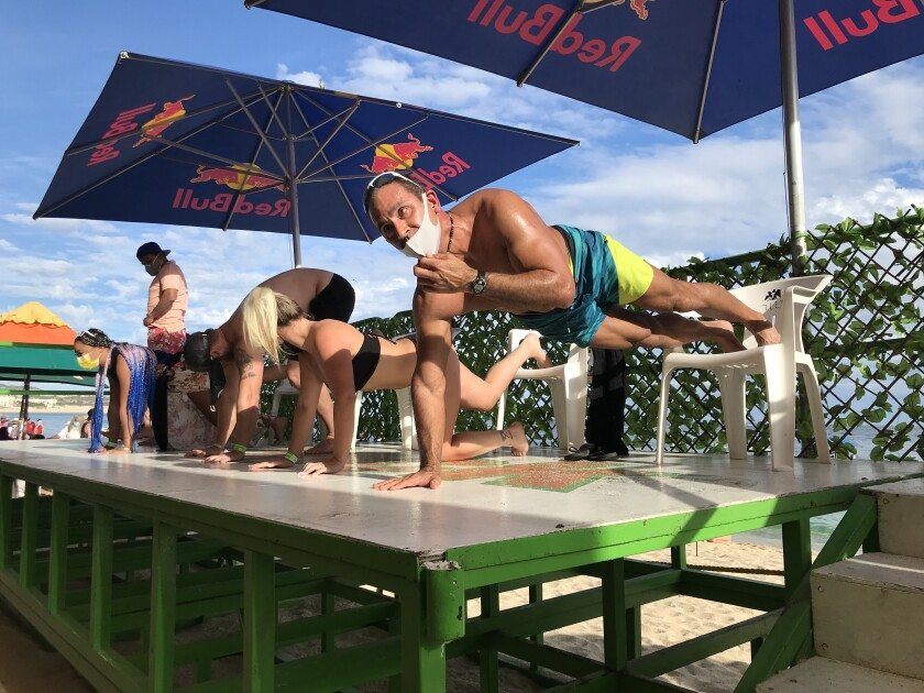 A push-up competition at Mango Deck, a beach bar in Cabo San Lucas.
