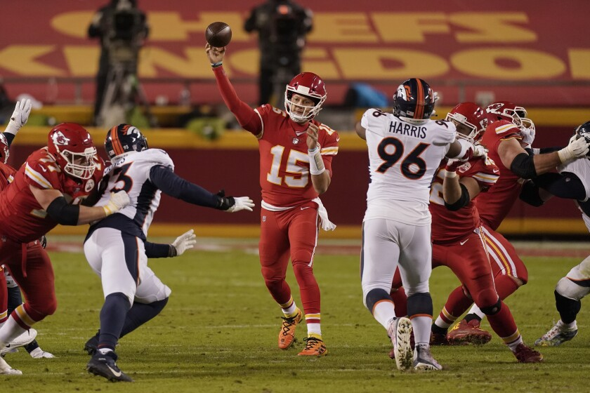 Kansas City Chiefs quarterback Patrick Mahomes (15) throws against the Denver Broncos in the second half of an NFL football game in Kansas City, Mo., Sunday, Dec. 6, 2020. (AP Photo/Charlie Riedel )