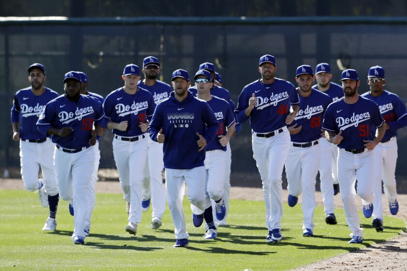 Los Angeles Dodgers pitchers warm up during spring training.
