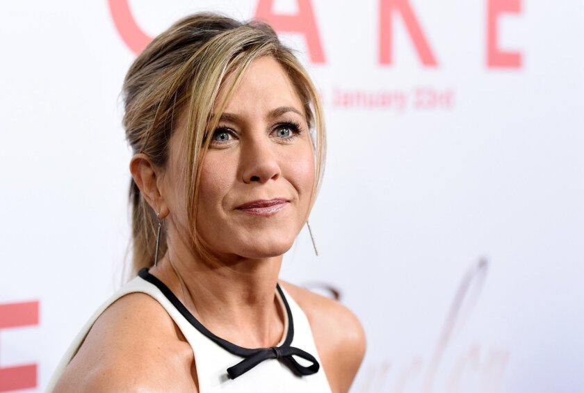 "FILE - In this  Jan. 14, 2015, file photo, Jennifer Aniston, a cast member in ""Cake,"" poses at the premiere of the film at Arclight Cinemas in Los Angeles. Aniston announced the death of her mother, Nancy Dow, in a statement to People magazine on May 25, 2016. (Photo by Chris Pizzello/Invision/AP,"