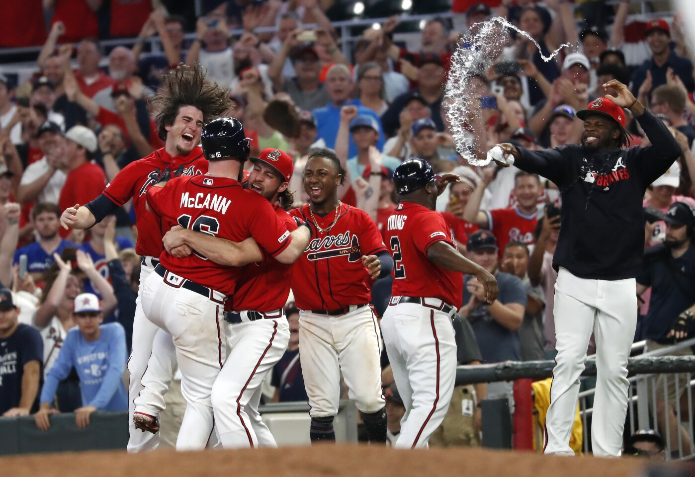 Atlanta Braves' Brian McCann (16) is mobbed by his teammates after driving in the winning run with a base hit in the ninth inning of a baseball game against the Miami Marlins early Saturday, July 6, 2019, in Atlanta. The Braves won 1-0. (AP Photo/John Bazemore)
