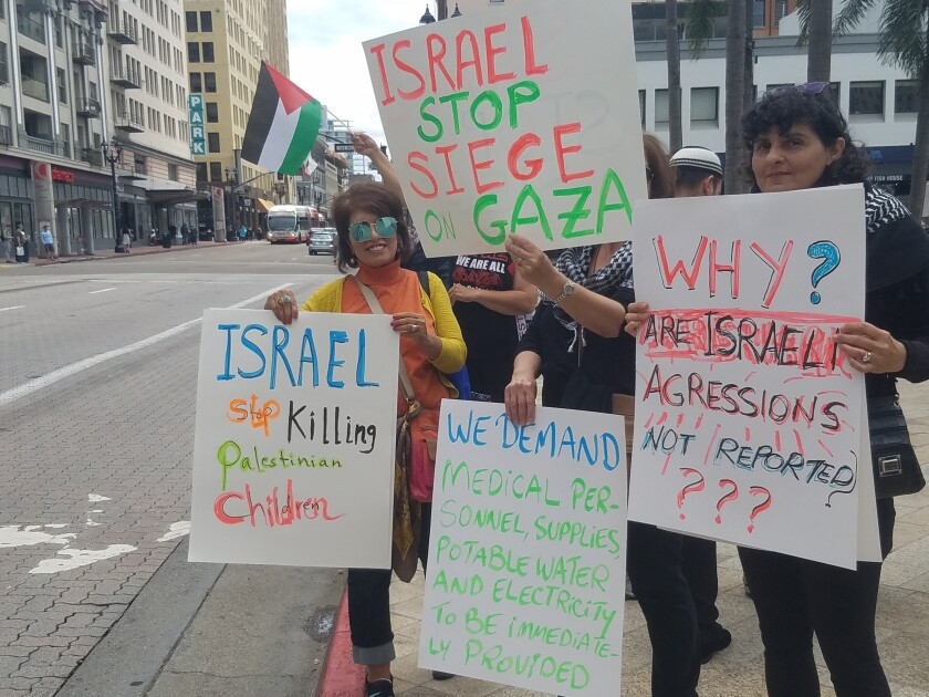Demonstrators called for an end to violence against Palestinians in Gaza at Horton Plaza in downtown San Diego on Monday.