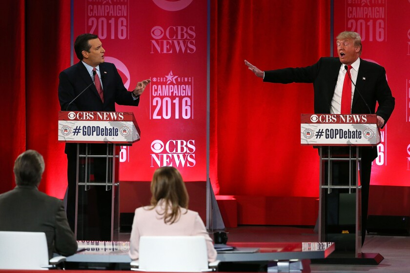 Republican presidential candidates Texas Sen. Ted Cruz, left, and businessman and reality-TV star Donald Trump clash in a debate on Saturday in Greenville, S.C.