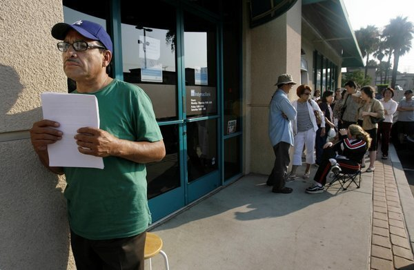 Miguel Gonzalez, left, waits for his appointment at an IndyMac Federal Bank in Monterey Park. IndyMac Chief Executive Michael W. Perry rarely met a nontraditional loan he didn't like, and the Pasadena savings and loan was sucked under by stated-income mortgages that required no documentation of ability to pay. As regulators seized IndyMac in July 2008, its branches resembled scenes from the Great Depression, with panicked depositors lining up in the heat to withdraw funds. Perry staunchly denied wrongdoing, portraying himself as the victim of the housing crash and overaggressive regulators. But he agreed in December 2012 to pay $1 million to settle government claims that he overloaded IndyMac with risky loans. He was also barred from the banking industry for life. Cost: $13 billion.