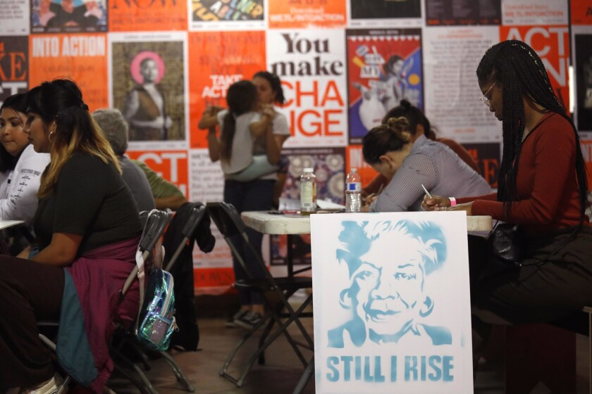 LOS ANGELES, CA - JANUARY 18, 2018 -- Ebony Freeman, right, seated next to a poster of poet Maya Ang