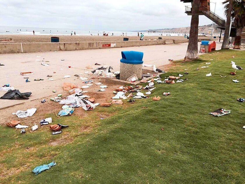 La Jolla Shores beach is covered with litter and debris from overflowing trash cans and possible culprit seagulls in search of food. La Jolla Light reader Caroline Chamales took this photo 8 a.m. Sunday, Sept. 21, 2014.