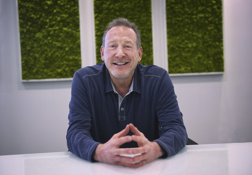 Jeffrey Berns, founder and CEO of Blockchains, poses for a portrait at their corporate headquarters east of Reno on March 2, 2021 in, Nev. A former school teacher has sued Berns, the CEO of a major cryptocurrency company that wants to build a smart city in the Nevada desert. She's accusing Berns and his wife of creating a hostile workplace and sexually harassing her at their Lake Tahoe home where she worked as a nanny, tutor and assistant. (Jason Bean/The Reno Gazette-Journal via AP)