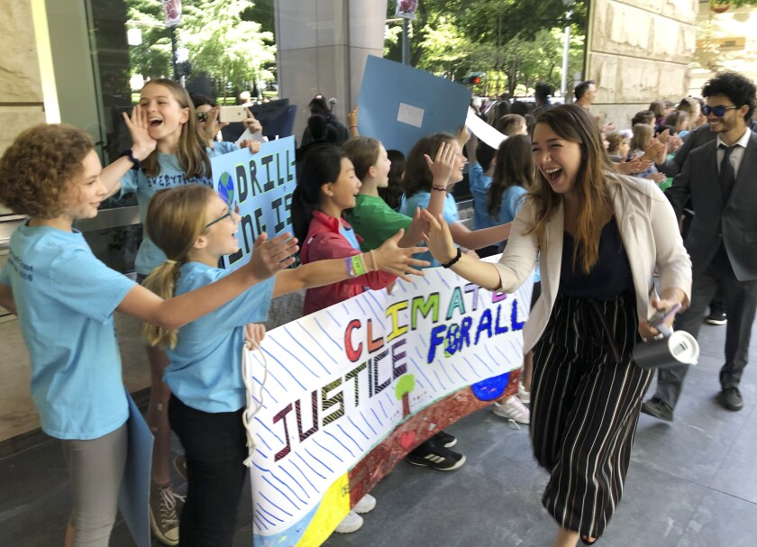 Kelsey Juliana, of Eugene, Ore., greets supporters outside a federal courthouse in Portland on June 4, 2019. Juliana was a lead plaintiff in a climate change lawsuit that was dismissed on Friday.