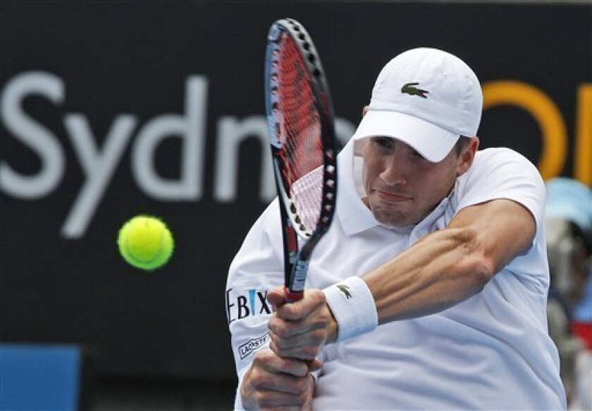 John Isner of the United State plays a backhand shot to fellow countryman Ryan Harrison at the Sydney International Tennis tournament in Sydney, Australia, Wednesday, Jan. 9, 2013.(AP Photo/Rob Griffith)